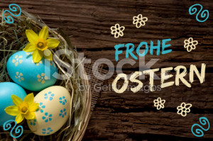 stock-photo-84913131-easter-eggs-on-wood-with-lettering-frohe-ostern